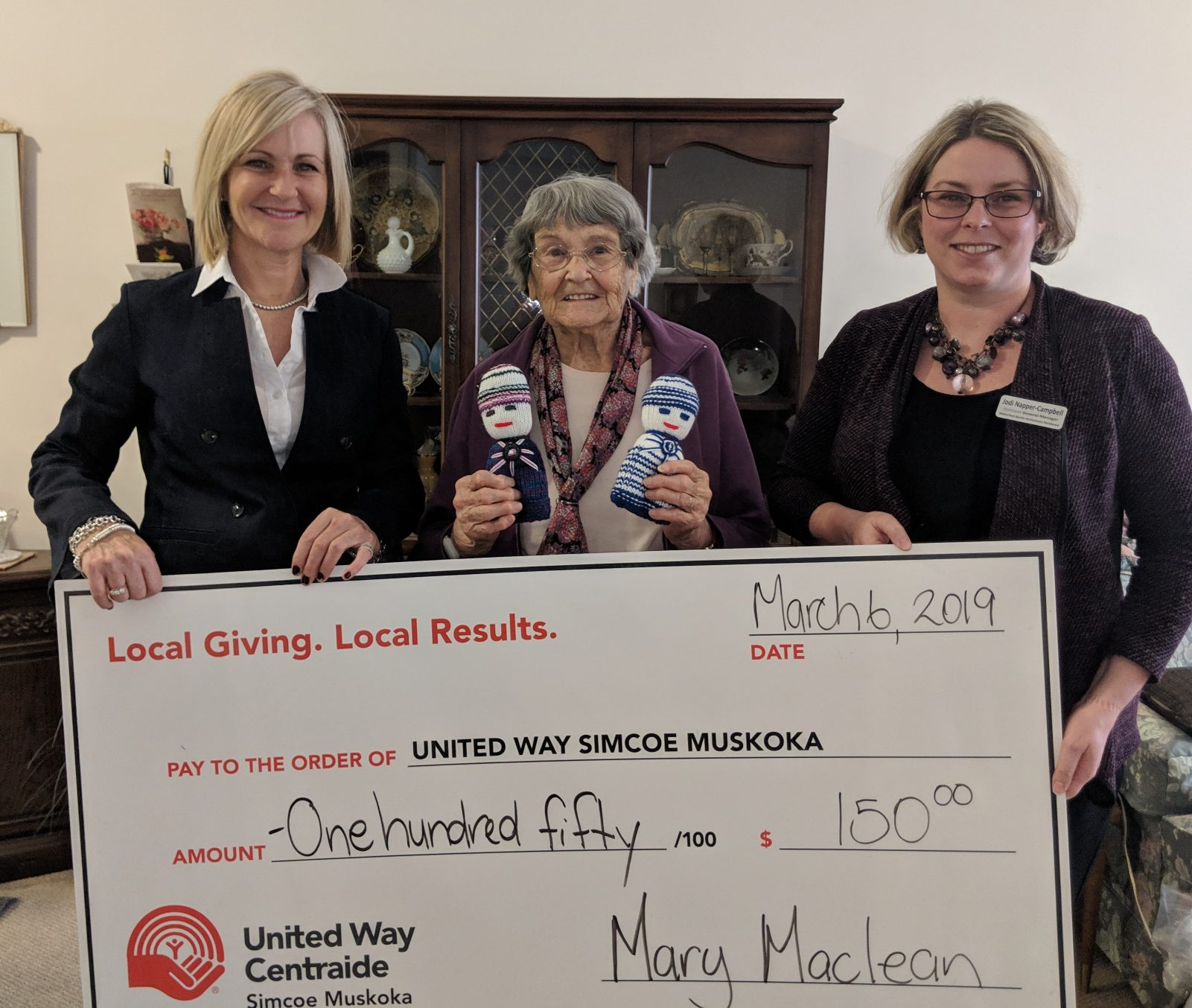 RM Lori-Ann presenting Mary with a cheque for $150